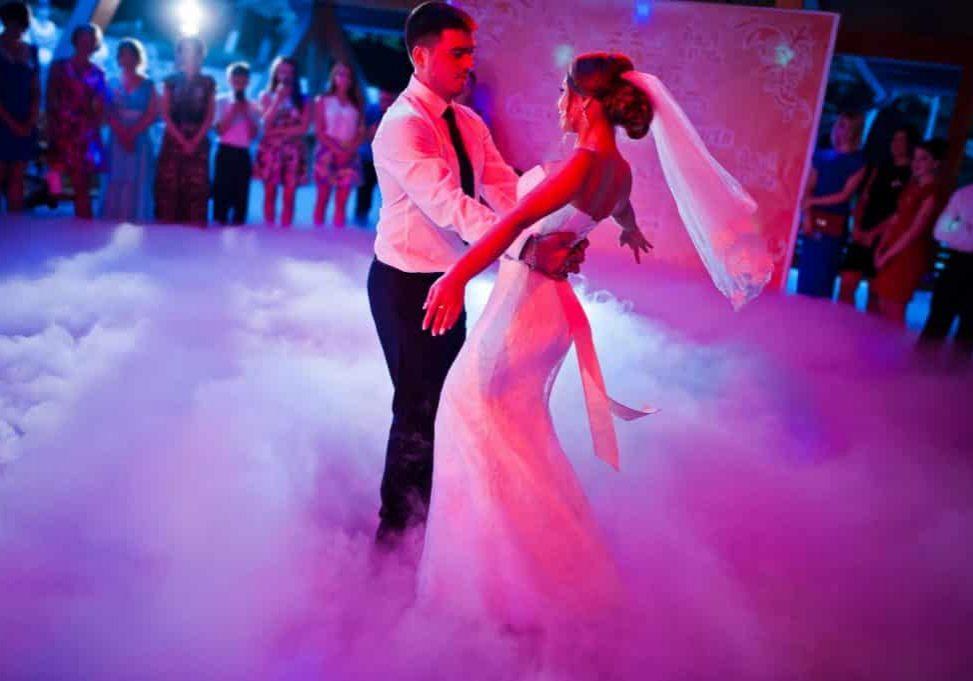 47331027 - amazing first wedding dance on heavy smoke